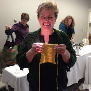 Britta beaming with her brilliant knitting